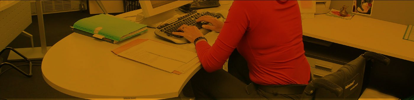 Woman sitting at a desk typing