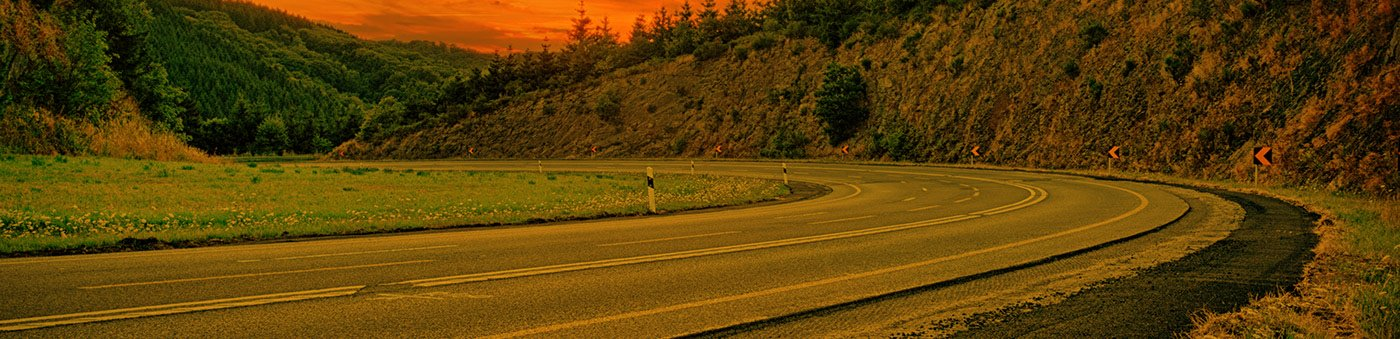 Winding mountain road at sunset