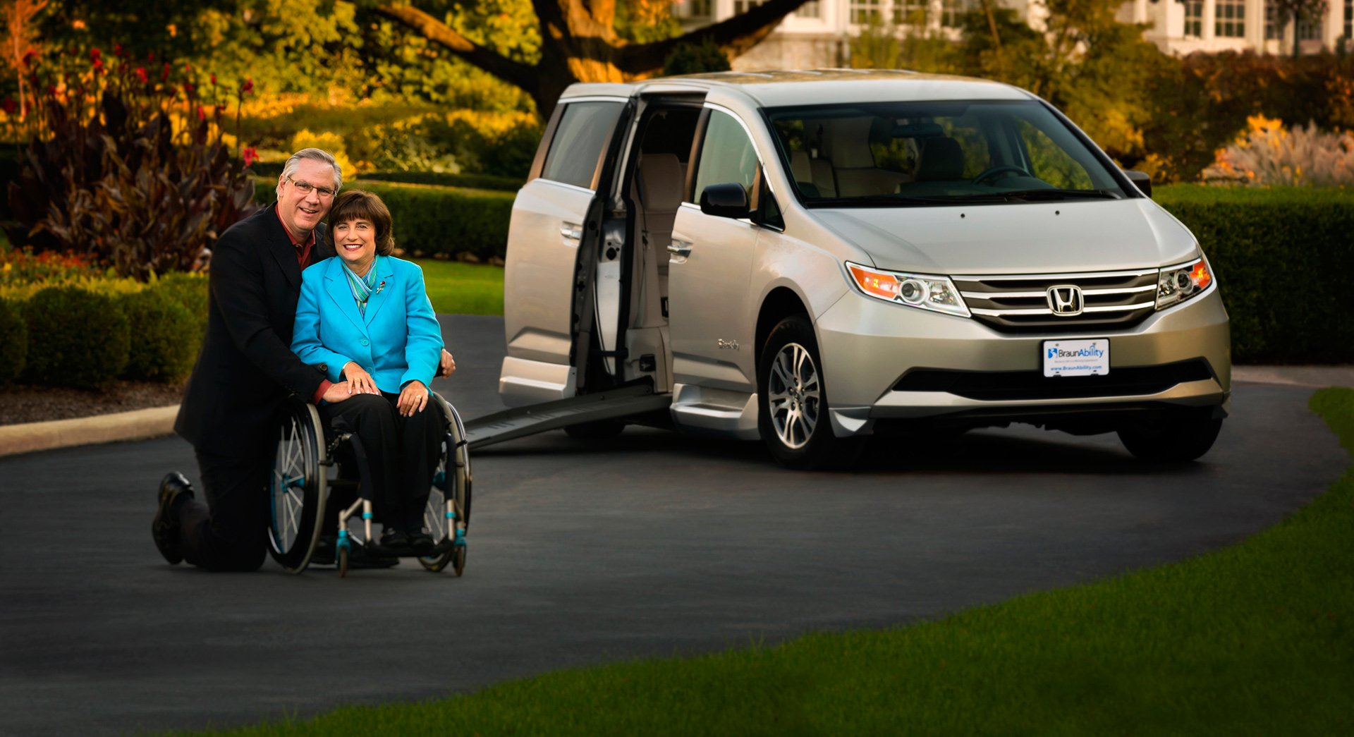 Inter-ability Husband and Wife Next to Wheelchair Van