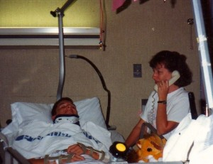 Michael in hospital bed as mom answers the telephone