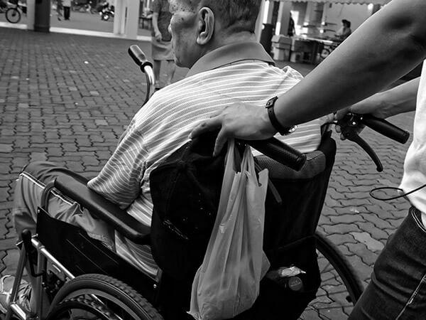elderly man in a wheelchair